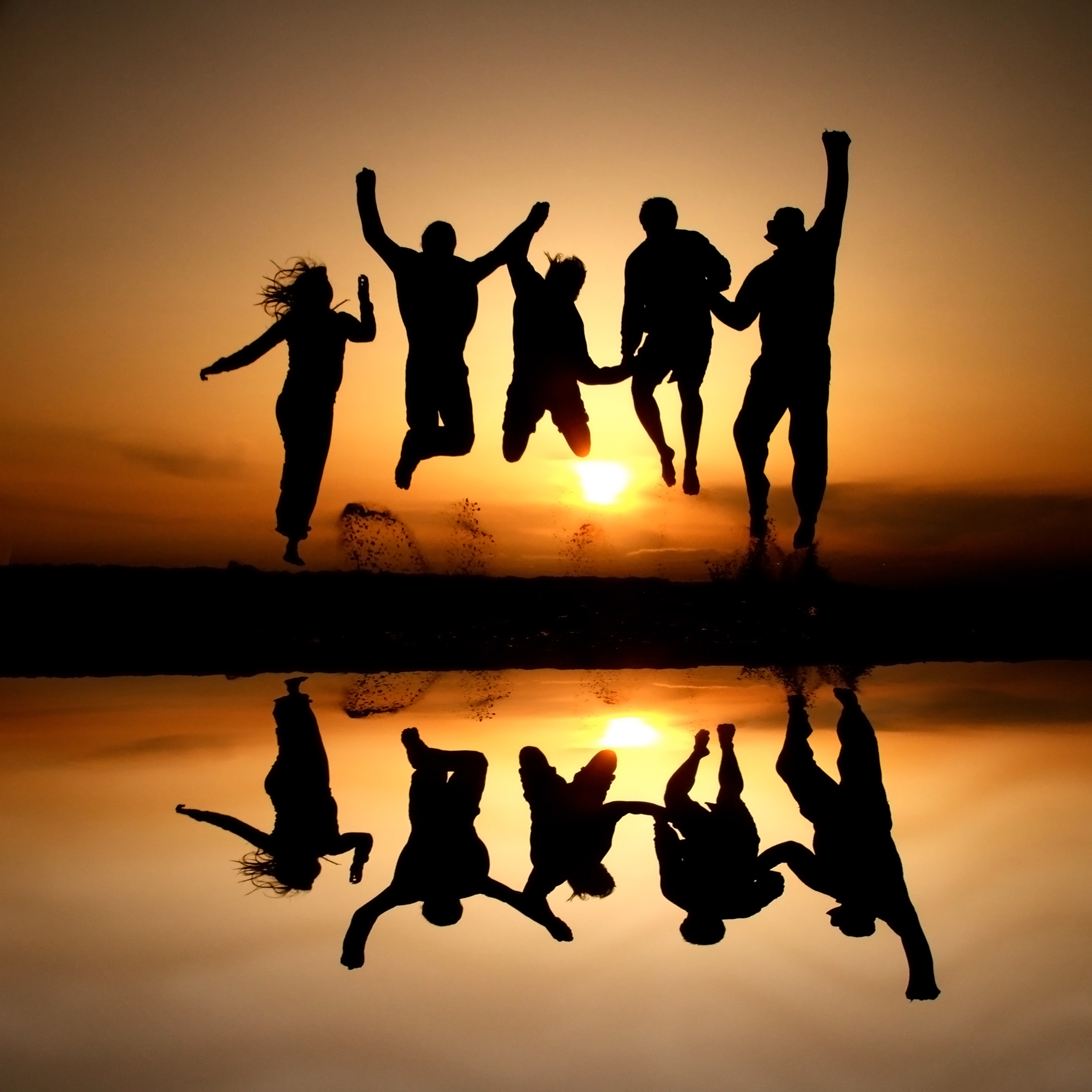 Silhoutte of group of people jumping